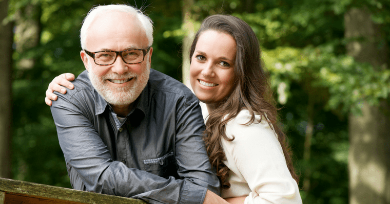 An older couple smiling with metal-free implants from Kirkland Dentist Dr. Shawn Keller
