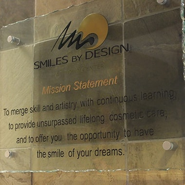 The mission statement displayed at the entrance of Smiles by Design