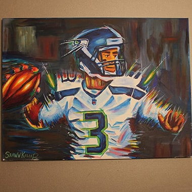 Painting of Seattle Seahawks quarterback Russel Wilson displayed in the waiting room of Smiles by Design
